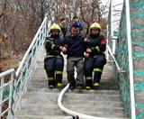 本溪市公安消防、森林消防、公墓消防自救队举行联合灭火救援演练5.jpg